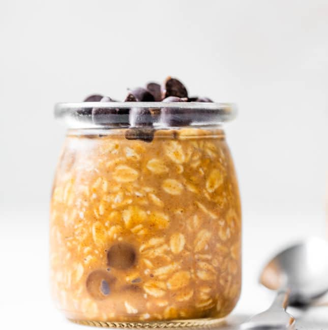 a jar of overnight oats topped with chocolate chips