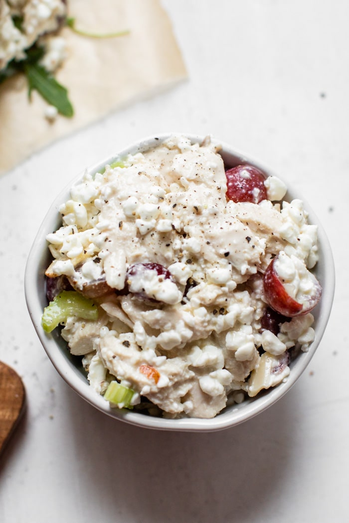 chicken with mayo and grapes in a bowl