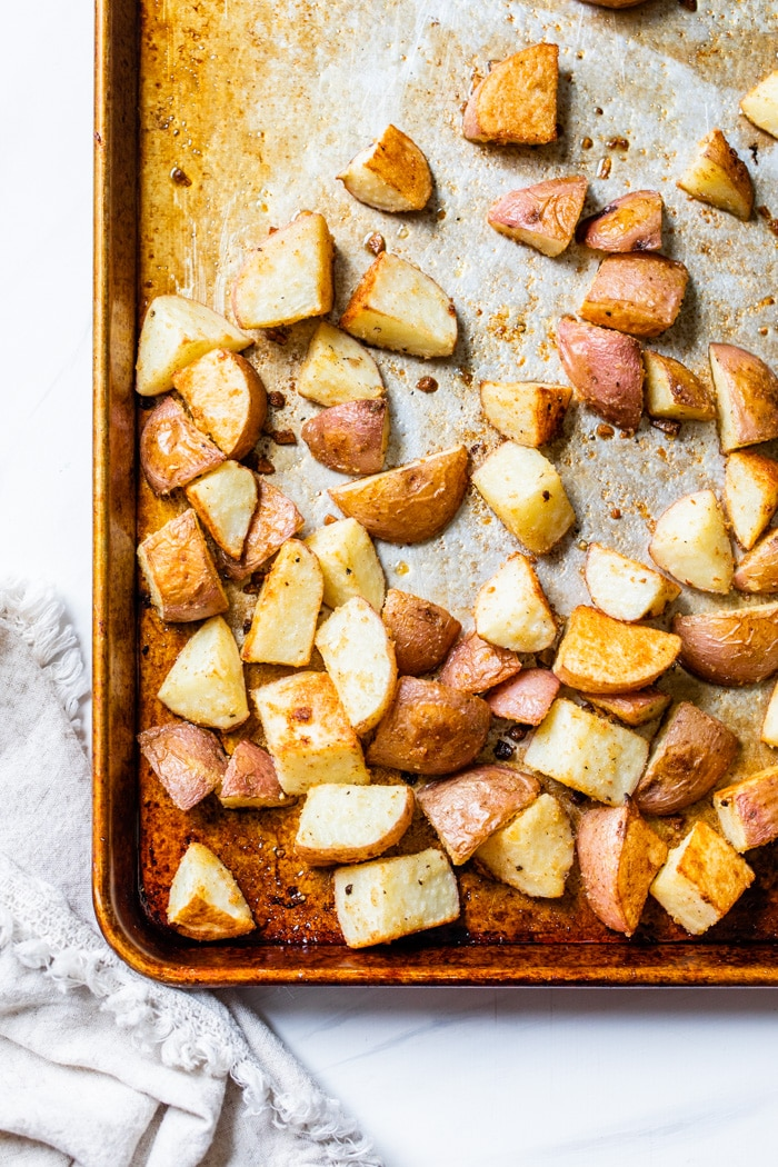 a baking sheet with roasted potatoes