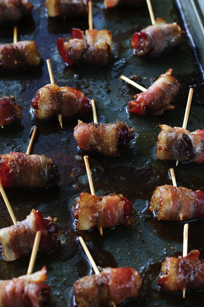 30 MINUTES 4 INGREDIENTS dates wrapped in bacon covered in syrup and sugar. The perfect WARM party appetizer!