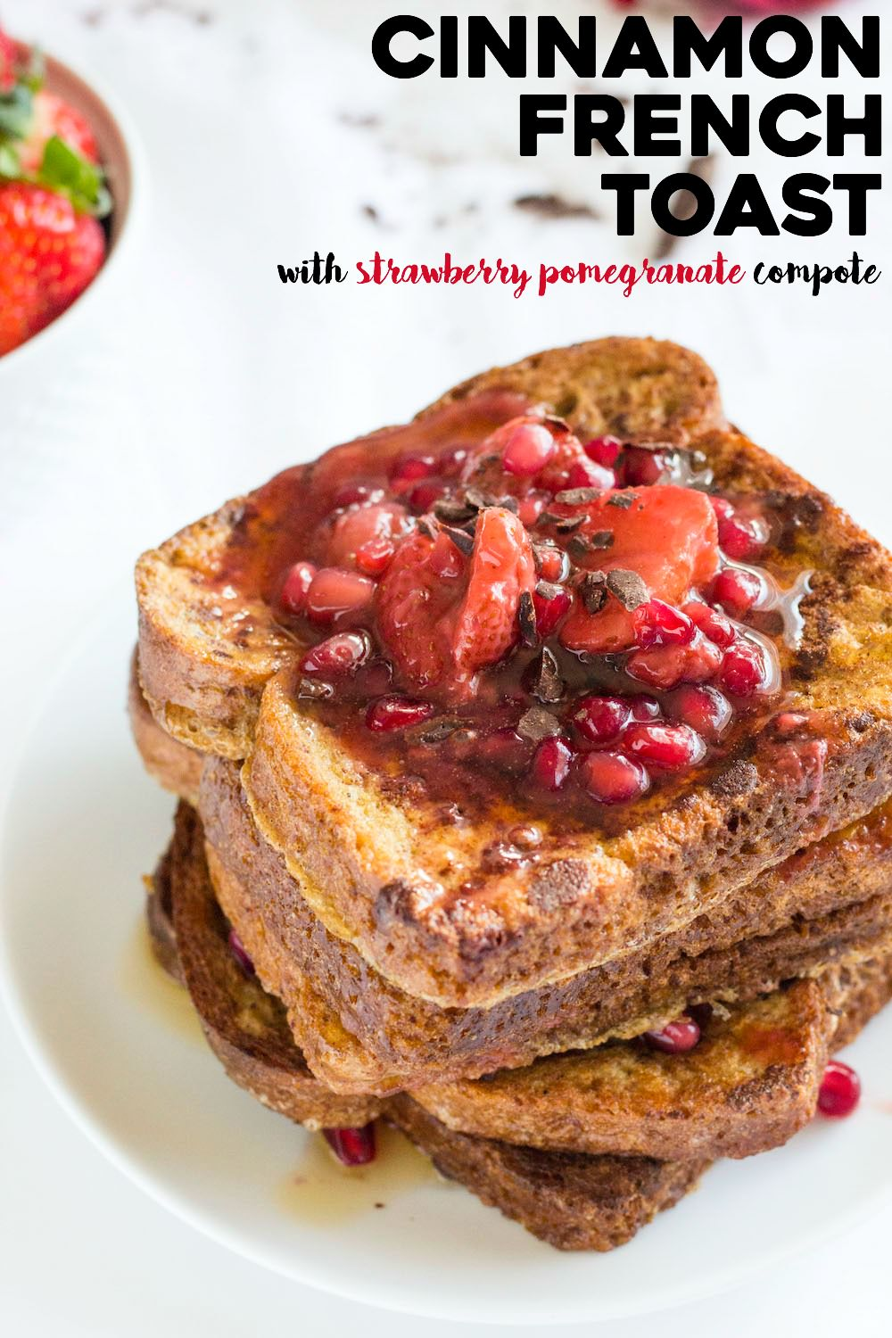 4-ingredient cinnamon french toast topped with 4-ingredient strawberry pomegranate compote. A delicious and healthy breakfast! | thealmondeater.com