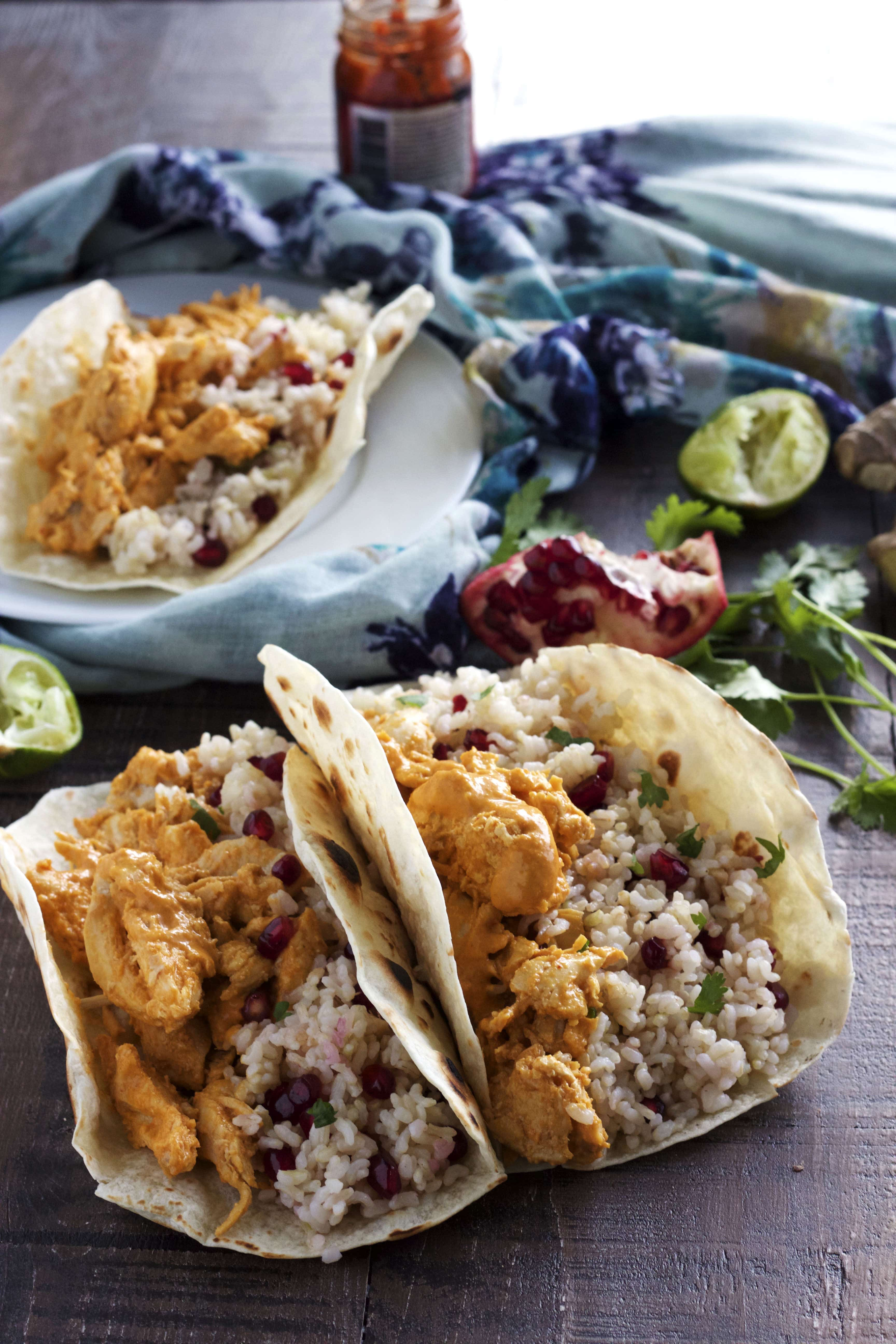 Chicken marinated in coconut milk and curry sauce and put into a taco with pomegranate rice. All in under 30 minutes!