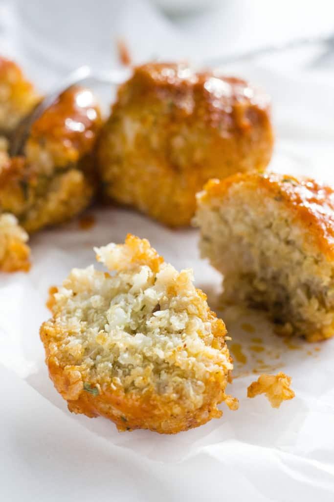 Buffalo Cauliflower Quinoa Meatballs   Delicious and simple vegetarian meatballs made from cauliflower and quinoa!   thealmondeater.com
