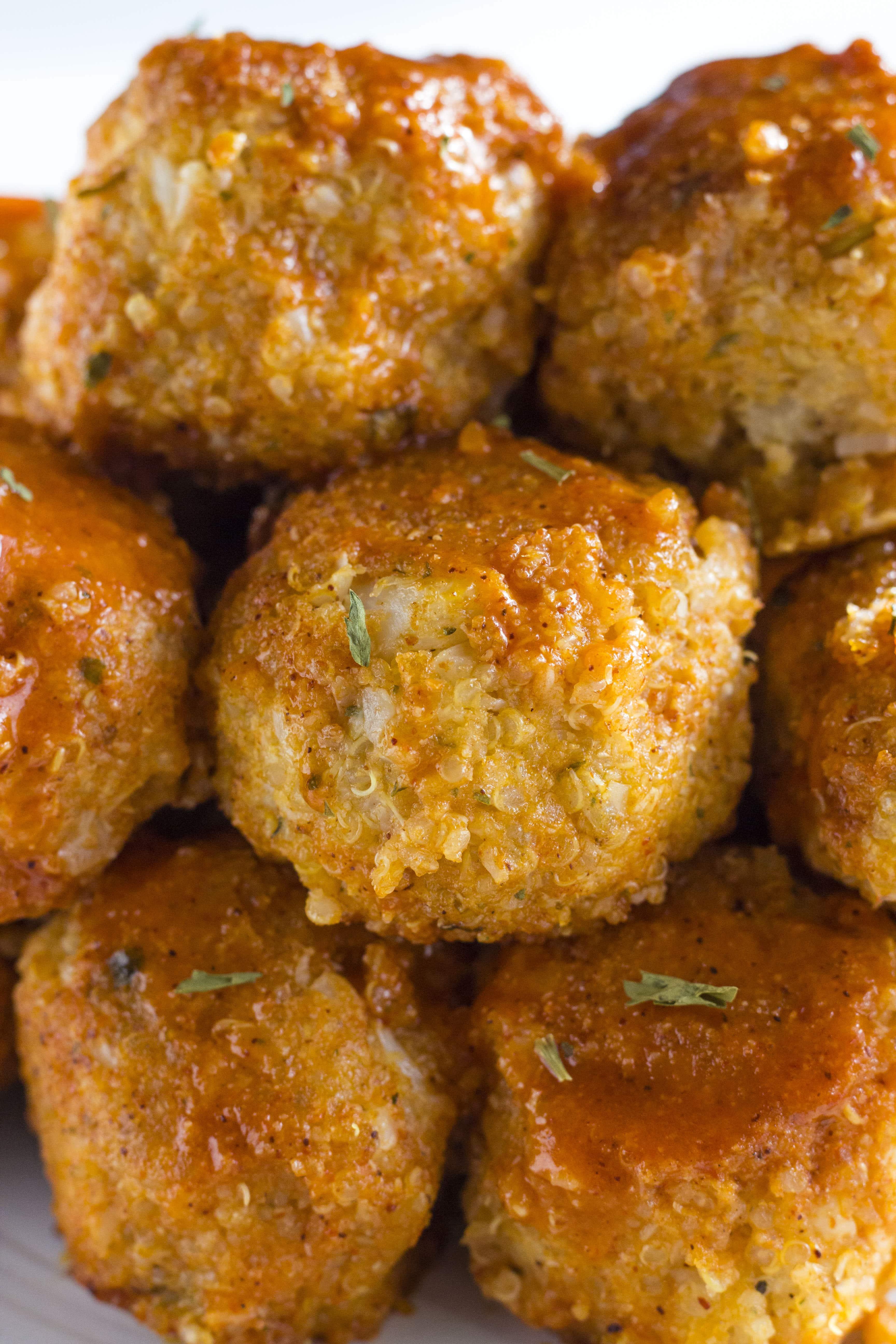 Buffalo Cauliflower Quinoa Meatballs   Delicious meatless meatballs marinaded in homemade buffalo sauce!   thealmondeater.com