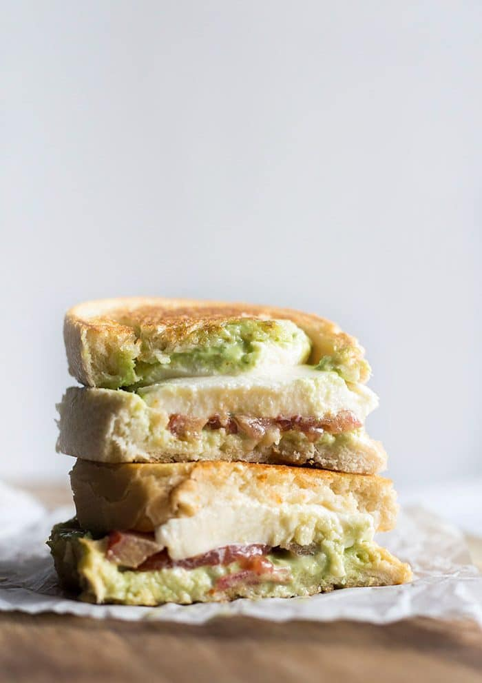 Caprese Grilled Cheese with Basil Mayonnaise | Tomato, fresh mozzarella and a super simple basil mayonnaise--a delicious take on the traditional grilled cheese!