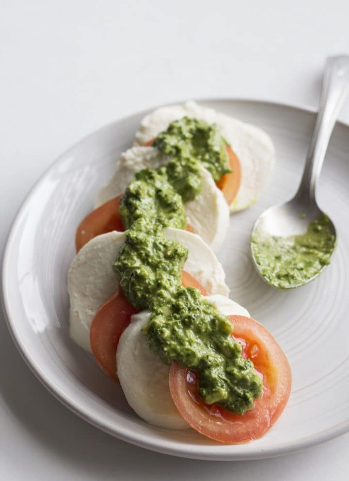Caprese Salad with Kale Pesto | Fresh mozzarella and tomatoes topped with kale pesto--a delicious appetizer or lunch!