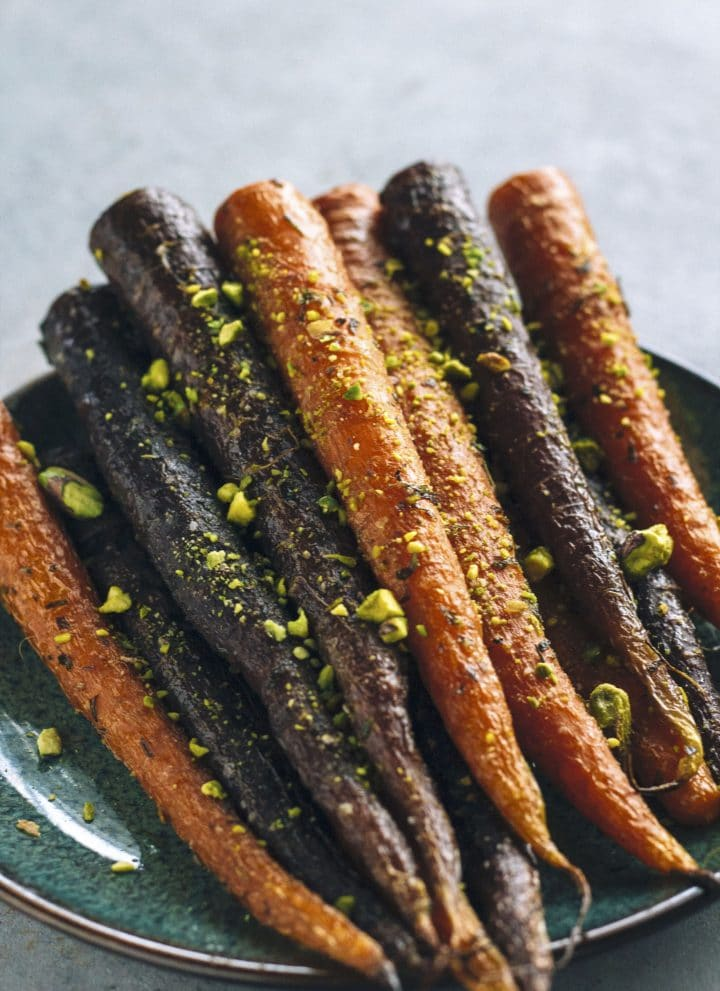 Pistachio-Crusted Roasted Carrots | A great side dish topped with tarragon and pistachios | thealmondeater.com