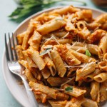 Pasta covered in a healthy & creamy sun-dried tomato pesto. A tasty vegetarian meal option!