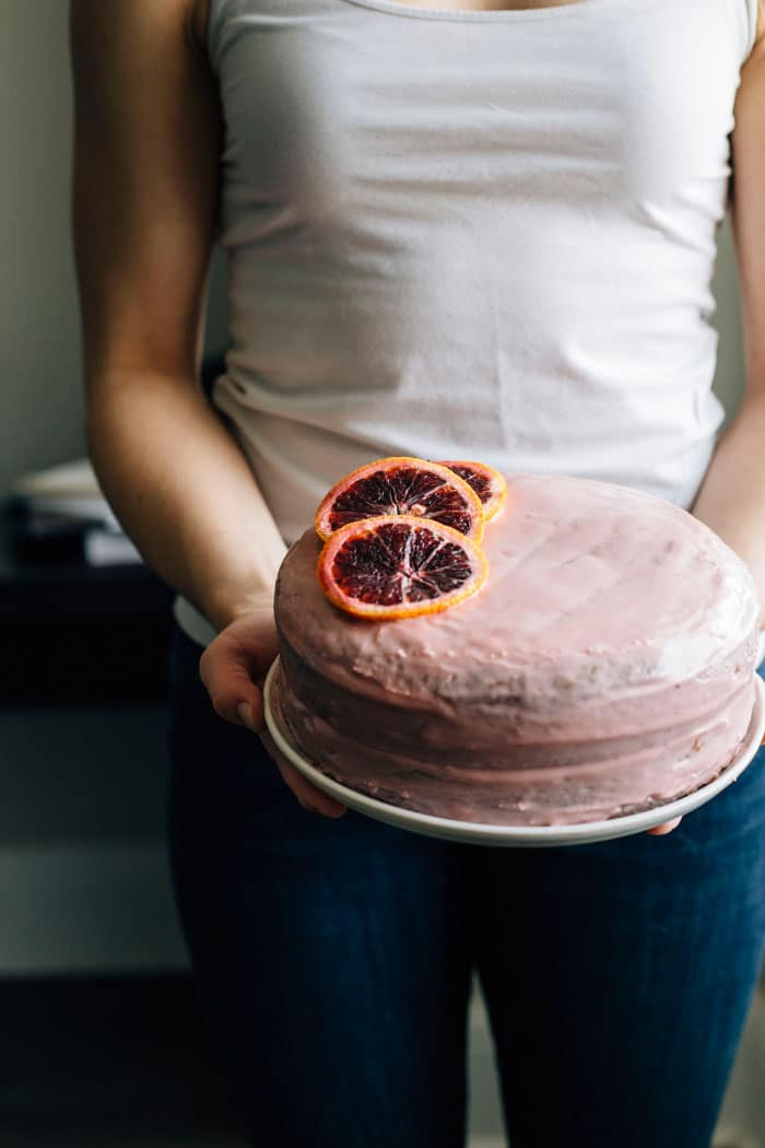 person holding a cake