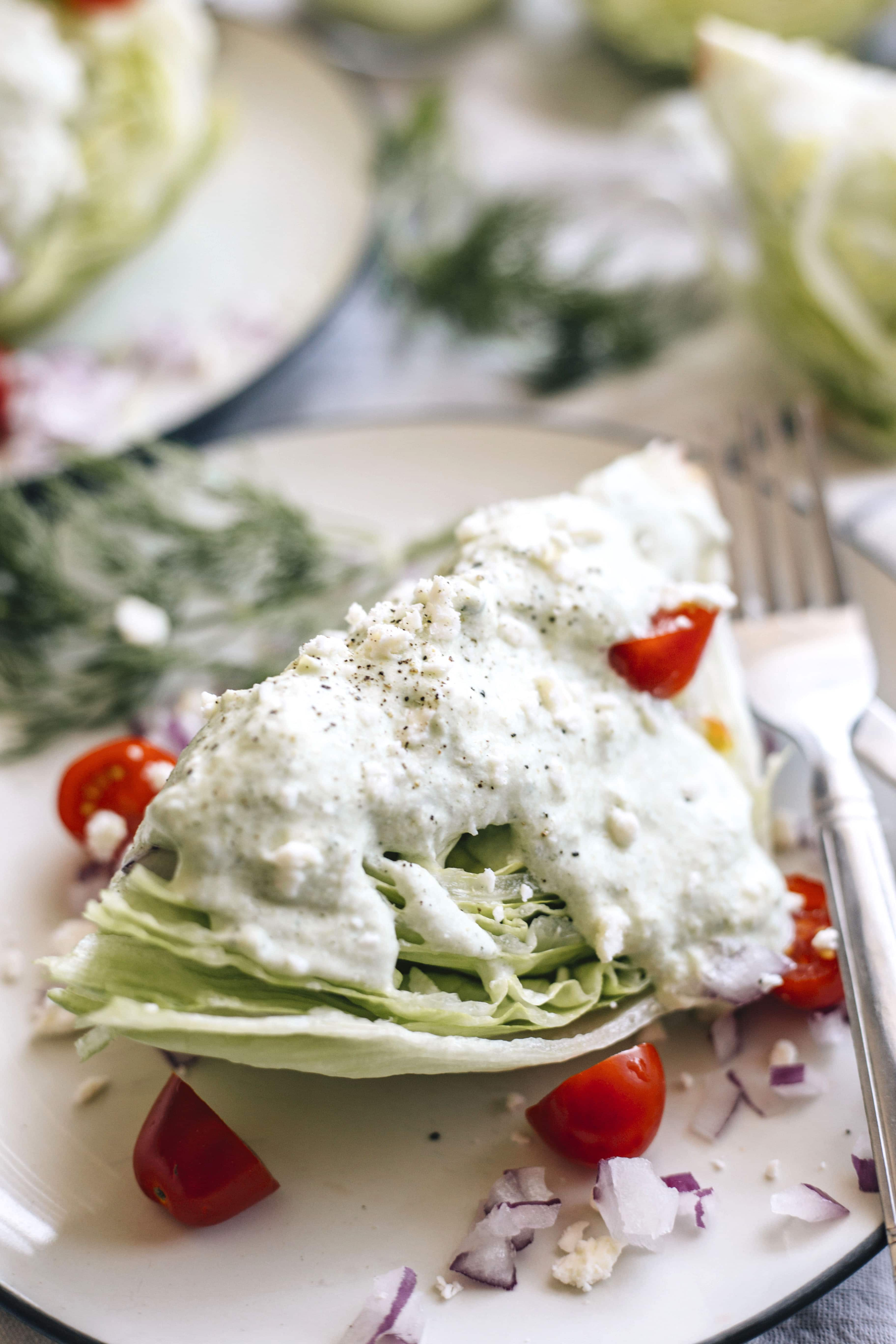 Greek Wedge Salad | A crunchy wedge salad topped with a creamy tzatziki dressing!