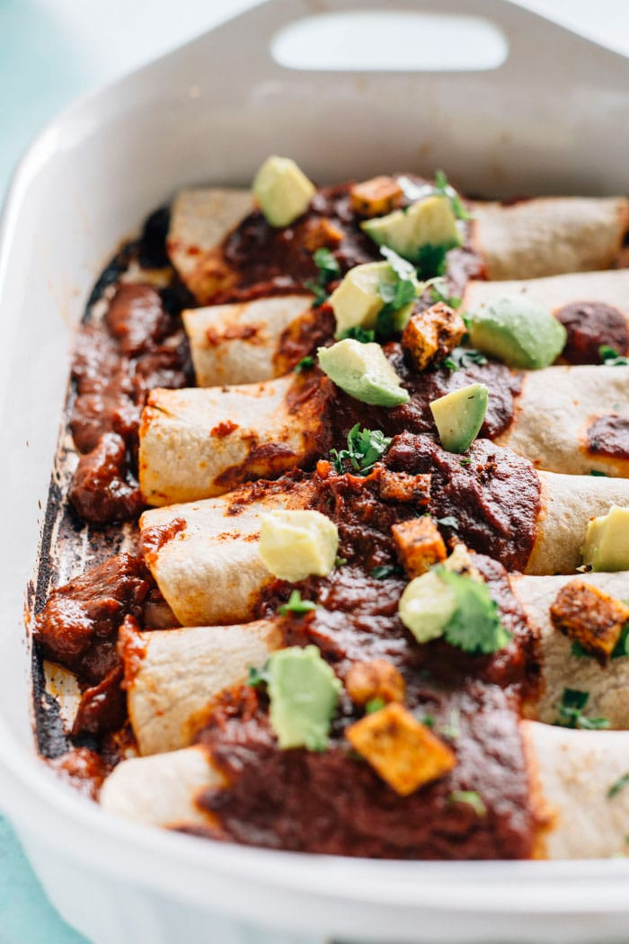 Spicy Tofu Vegan Enchiladas | Delicious enchiladas filled with crispy tofu, black beans and diced tomatoes | thealmondeater.com