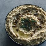 Traditional Hummus | A simple hummus recipe topped with toasted sesame seeds--ready in just 5 minutes!