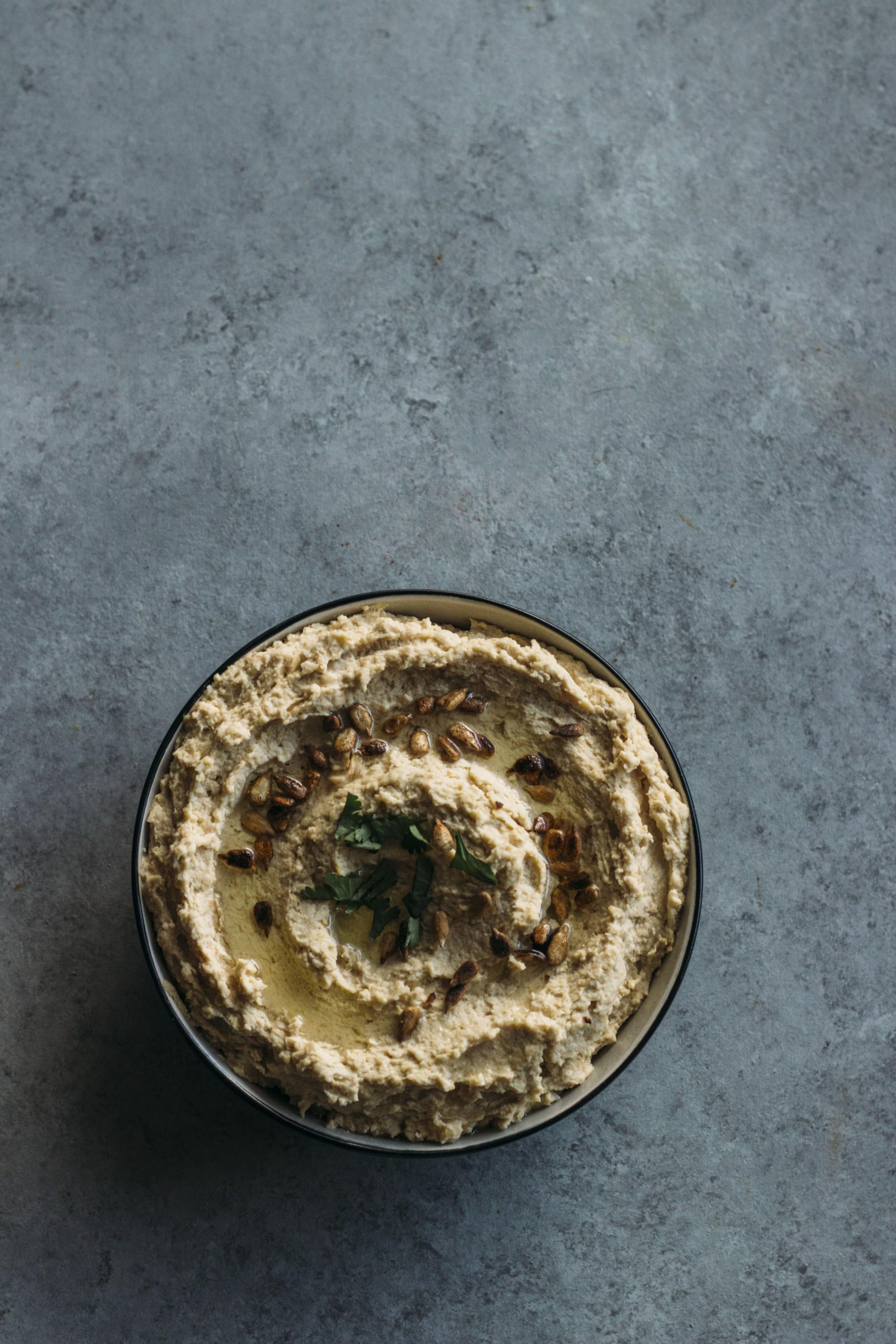 Traditional Hummus | A simple hummus recipe topped with sesame seeds--ready in just 5 minutes!