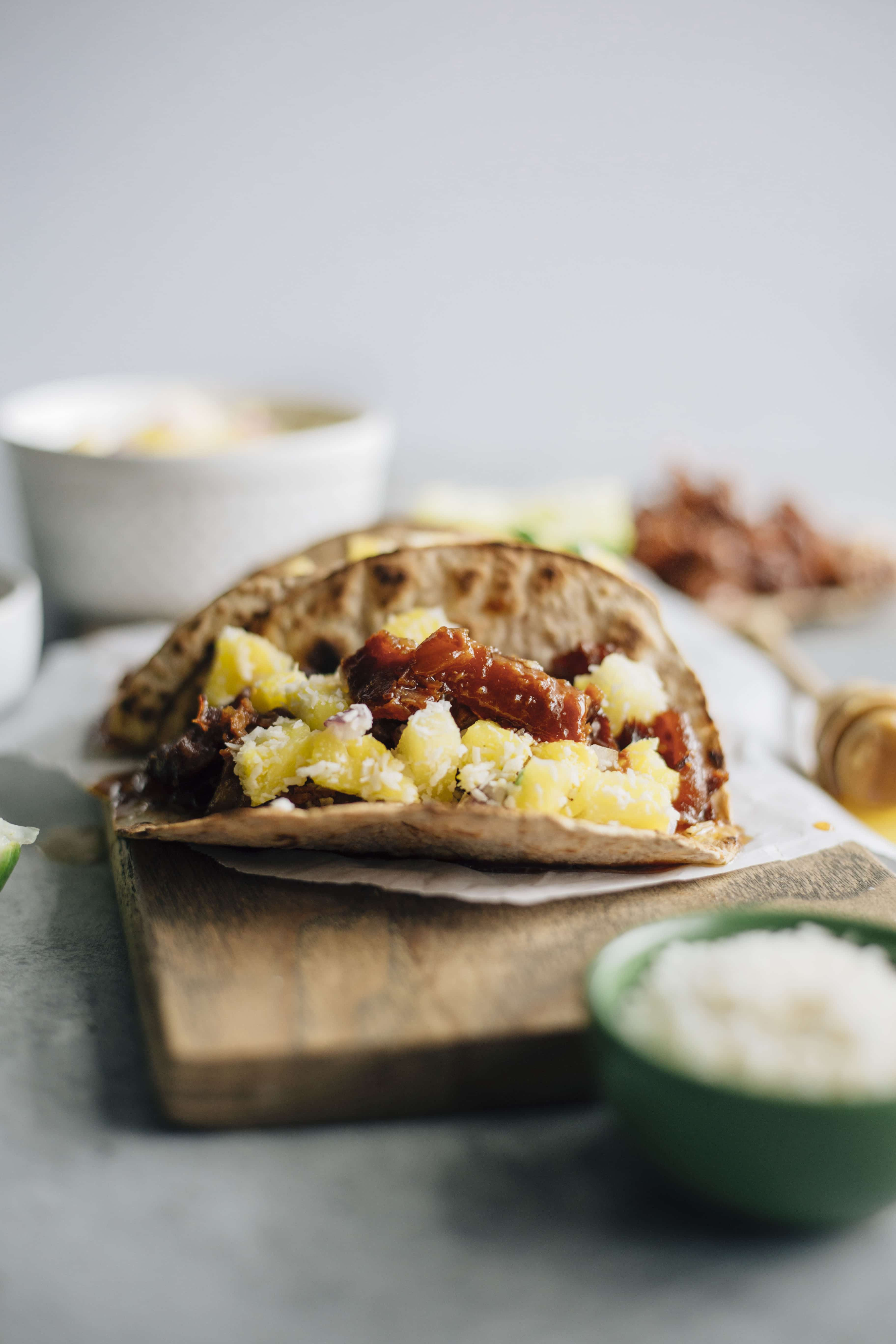 Honey Ginger Pork Tacos   Made in the slow cooker, marinaded in honey and ginger and topped with a simple pineapple salsa!