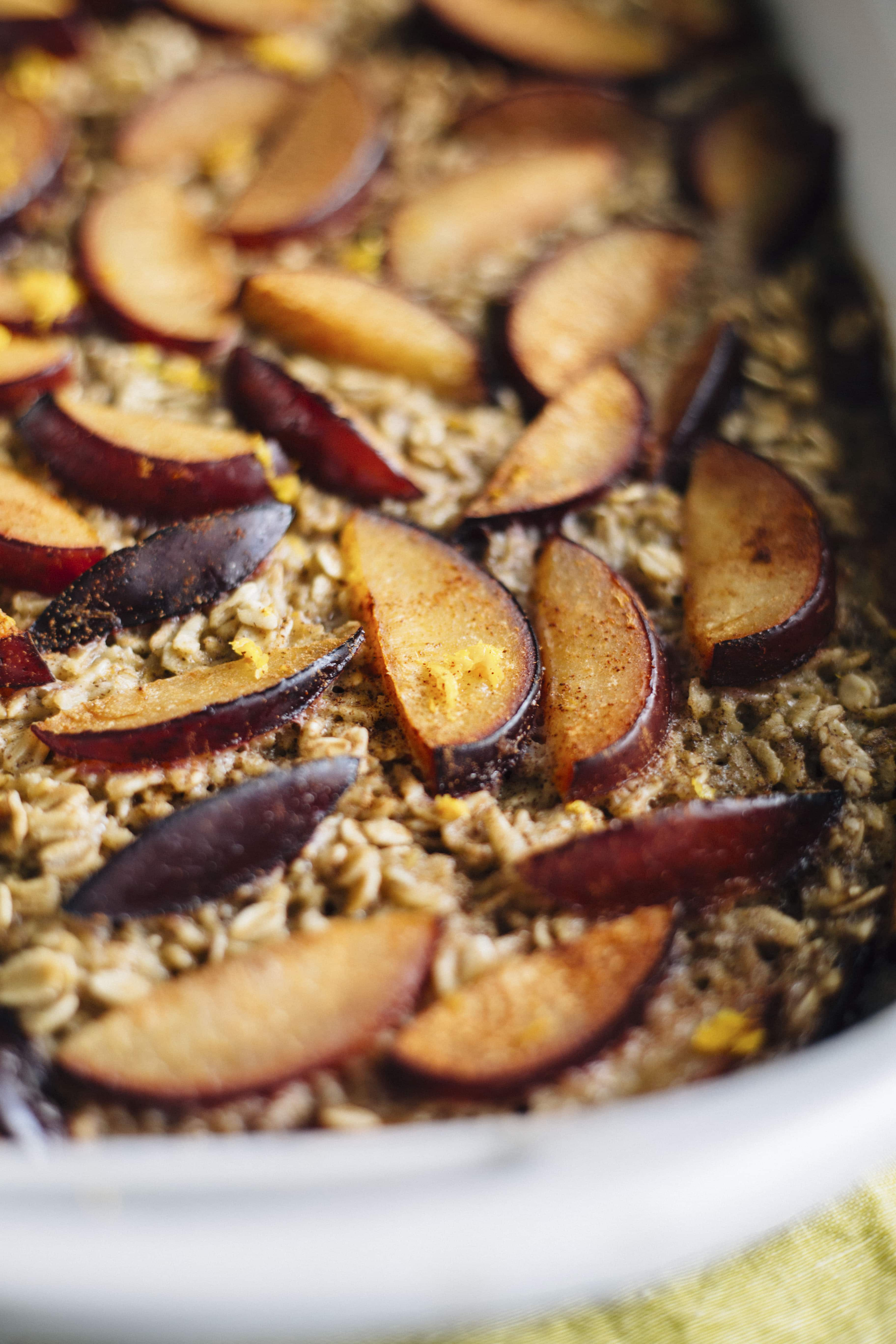 A delicious oatmeal bake filled with cinnamon, plums and orange zest!