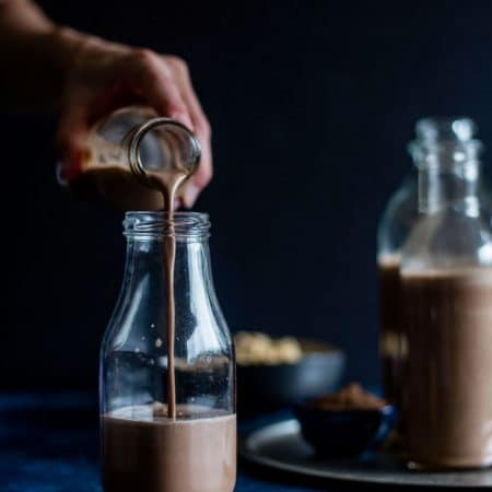 Chocolate Peanut Milk   This 4-ingredient recipe is a chocolate-y #dairyfree drink option made from peanuts and cacao!   thealmondeater.com