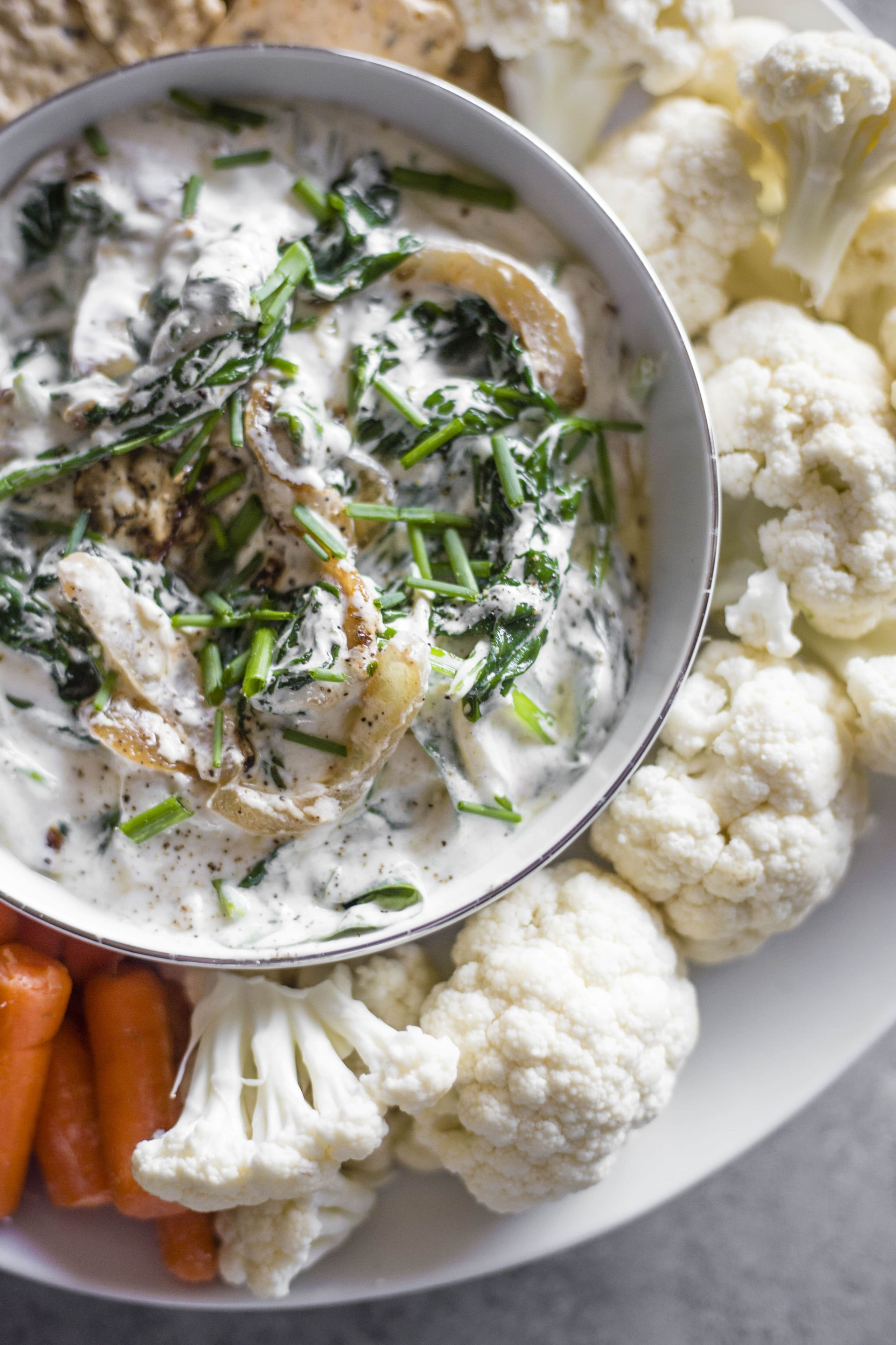 Spinach & Caramelized Onion Dip | A delicious dip that tastes like caramelized onions and is secretly healthy! | thealmondeater.com