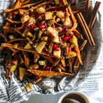 Caramel Apple Sweet Potato Fries | Homemade fries topped with caramel sauce and cinnamon apples! | thealmondeater.com