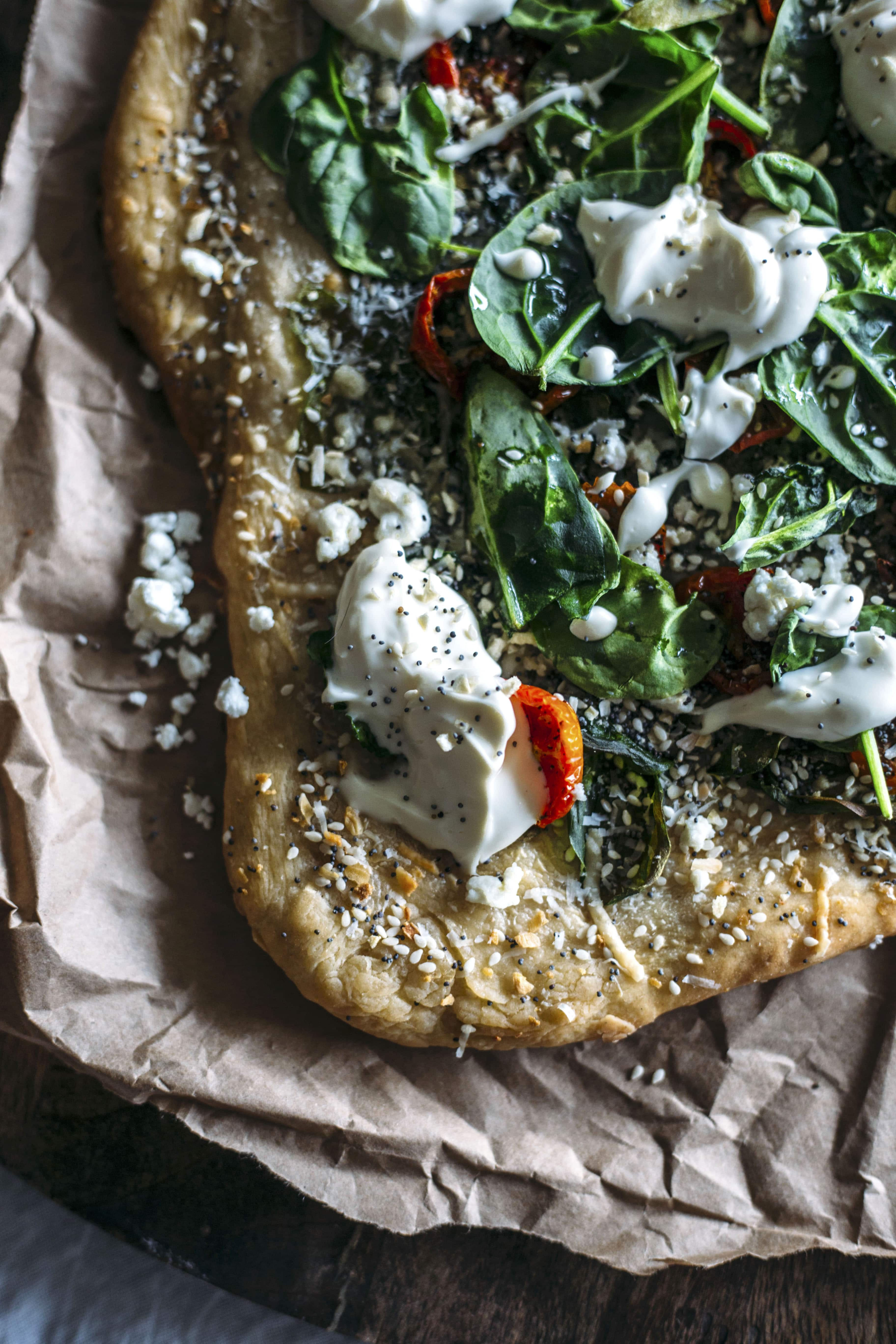 "Everything Bagel Pizza | Pizza topped with ""everything"" bagel seasoning, plus cheese, spinach and cream cheese! 