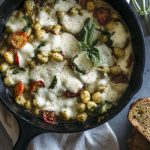 Gnocchi Filled Caprese Dip | Tomatoes, basil and mozzarella with pesto-marinated gnocchi, all in one delicious dip!