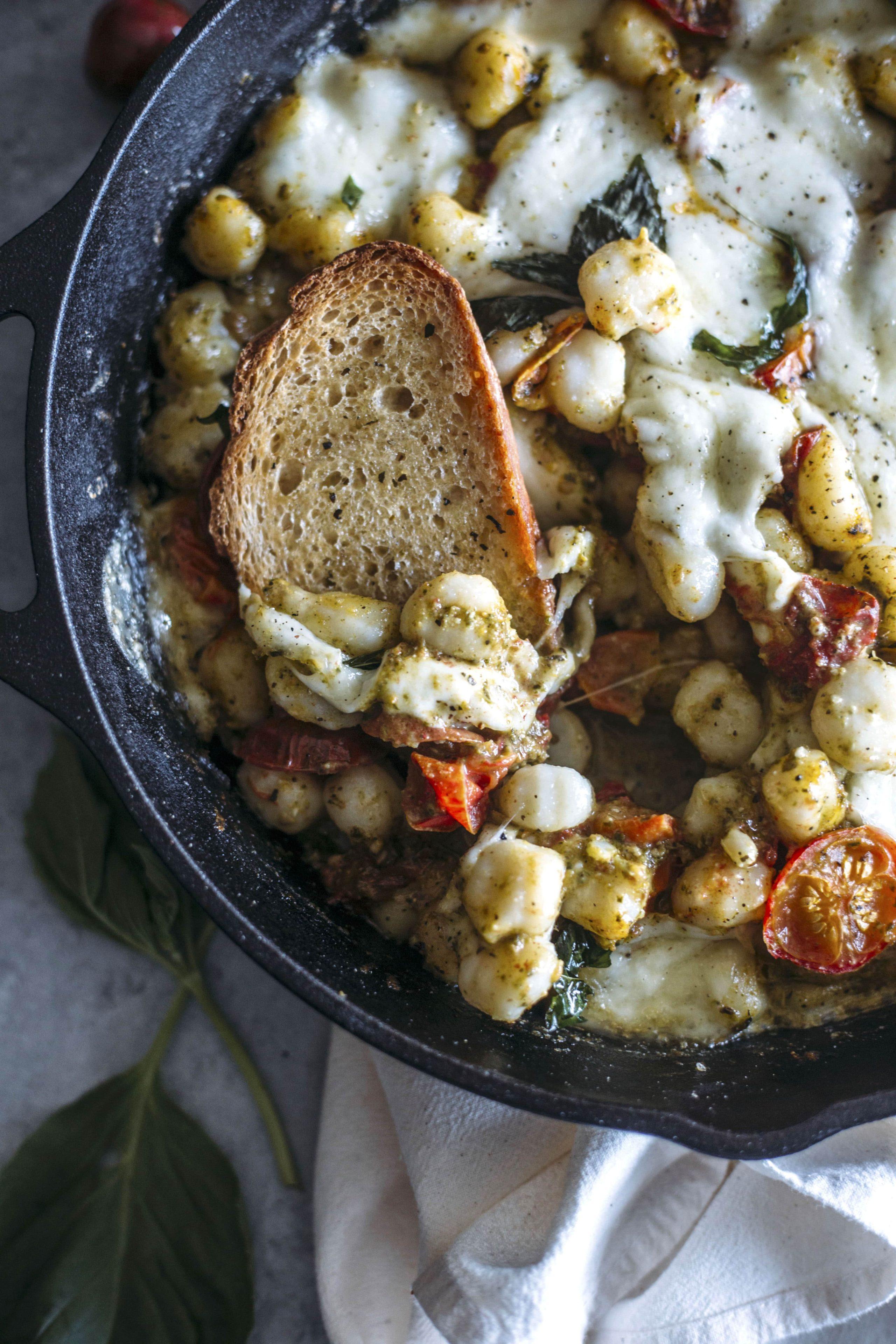 Gnocchi Filled Caprese Dip | Caprese flavors mix with pesto-marinated gnocchi in this delicious shareable dip!