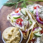 Mediterranean Chicken Tacos filled with tzatziki sauce, chicken, hummus, and veggies!