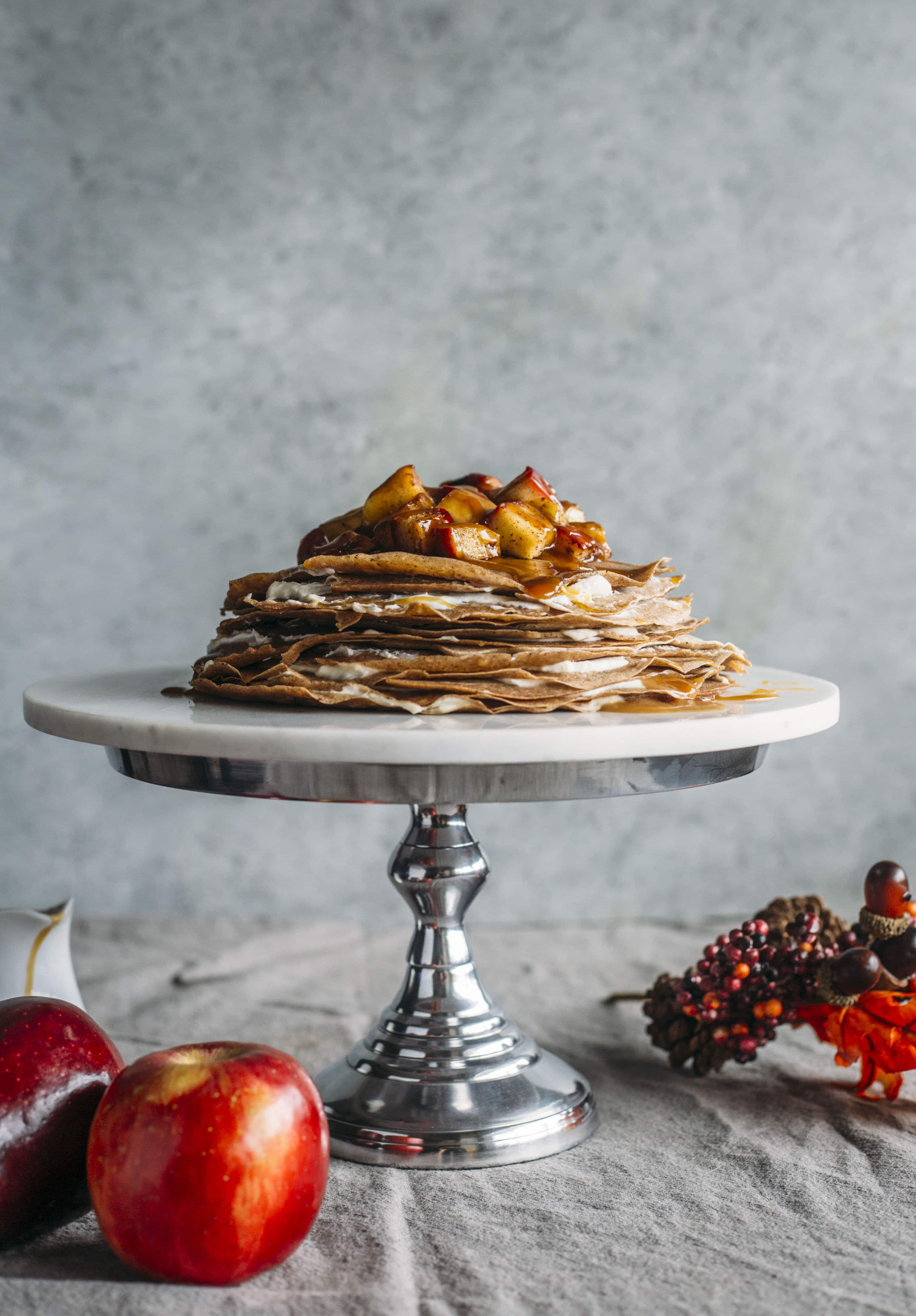Caramel Apple Crepe Cake | Crepes filled with mascarpone cheese and topped with apples and a healthier caramel sauce! | thealmondeater.com