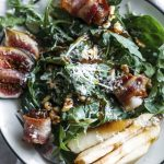 Pear Salad | This fall-flavored salad is topped with pears, fresh figs, bacon-wrapped dates, and a tasty cinnamon dressing! | thealmondeater.com