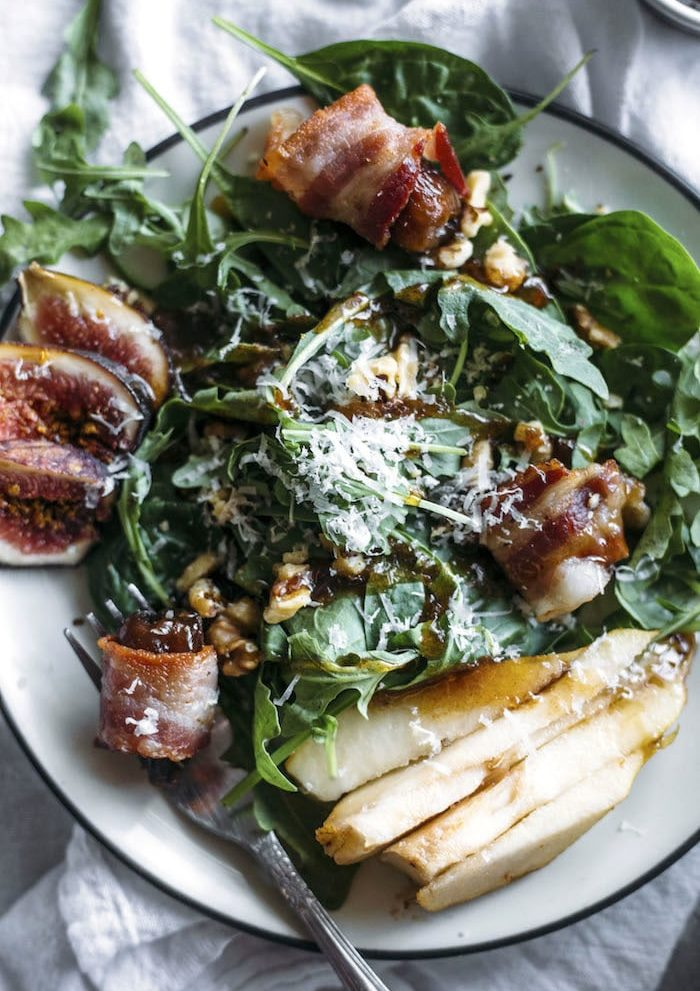 Pear Salad   This fall-flavored salad is topped with pears, fresh figs, bacon-wrapped dates, and a tasty cinnamon dressing!   thealmondeater.com
