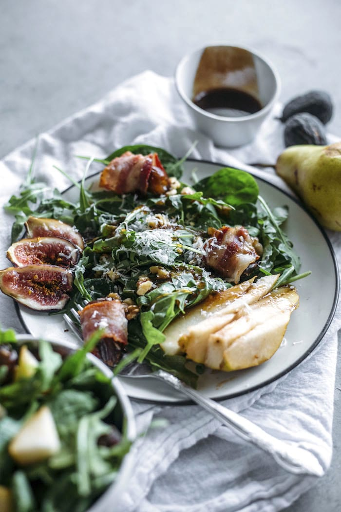 Pear Salad | This fall-flavored salad is topped with pears, fresh figs, bacon-wrapped dates, and a tasty dressing! | thealmondeater.com