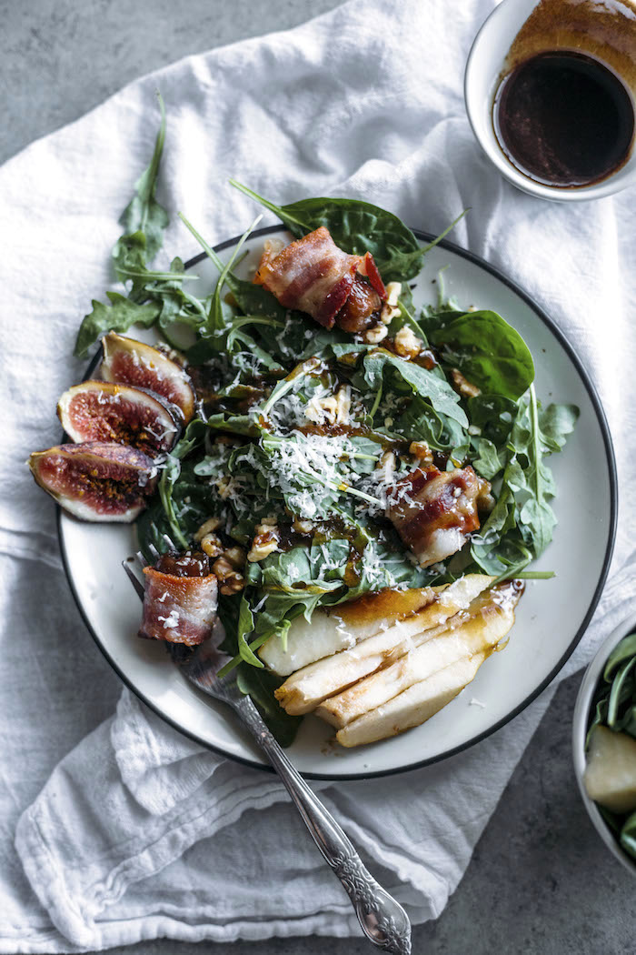 Pear Salad | This fall-inspired pear salad is topped with fresh figs, walnuts and a simple honey cinnamon dressing | thealmondeater.com