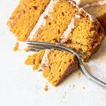 a slice of pumpkin cake with cinnamon buttercream