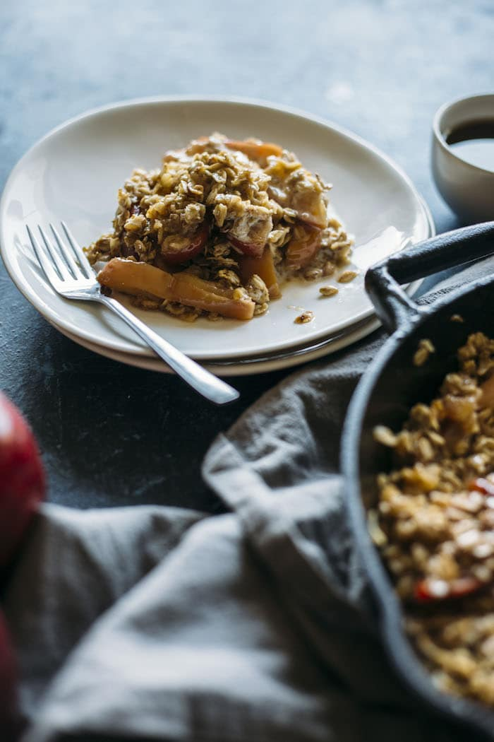 Caramel Apple Crumble Skillet | A one-dish dessert full of apples, cinnamon oats and caramel sauce! | thealmondeater.com