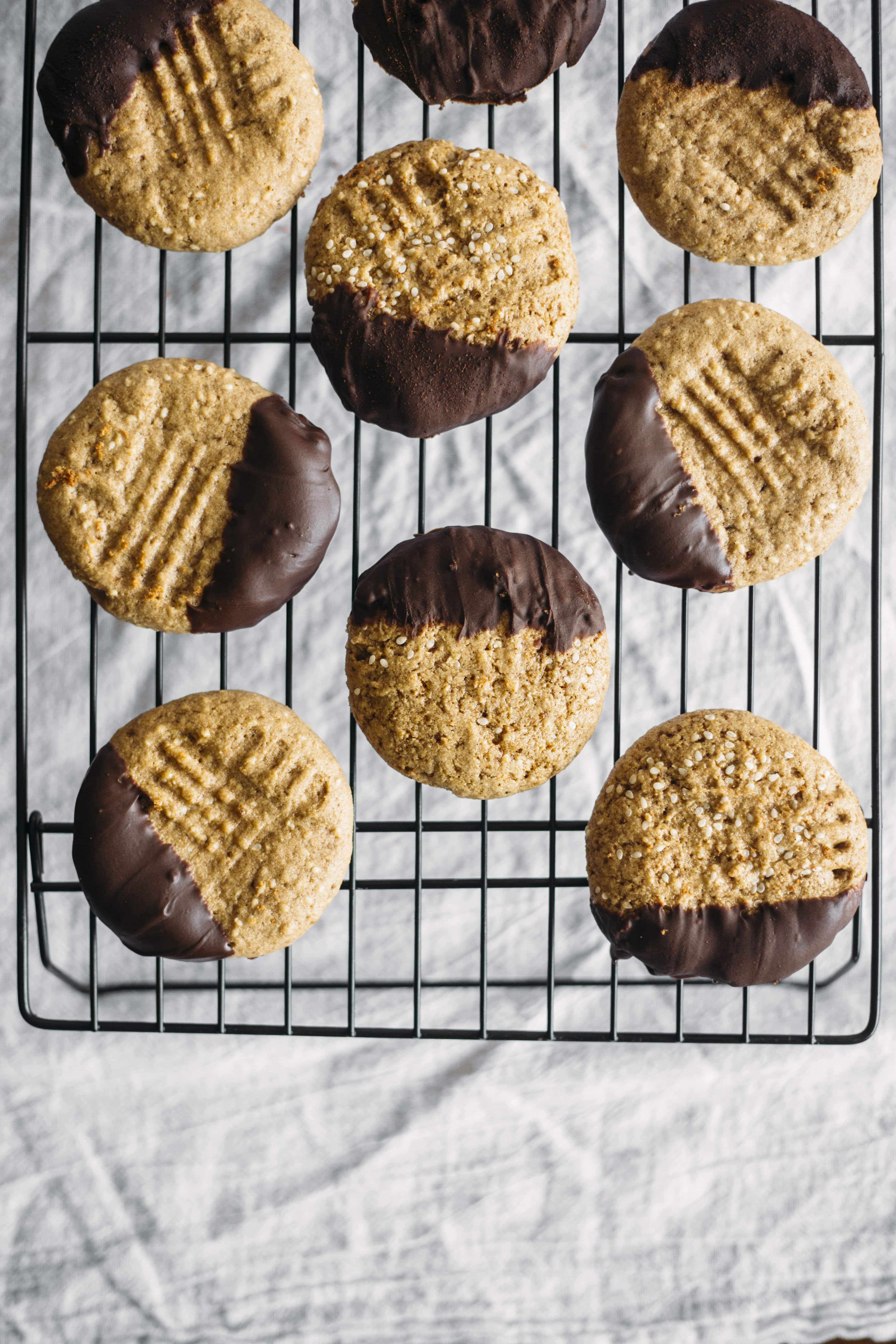 Chocolate Dipped Tahini Cookies | Tahini cookies with added sweetness thanks to the addition of CHOCOLATE!