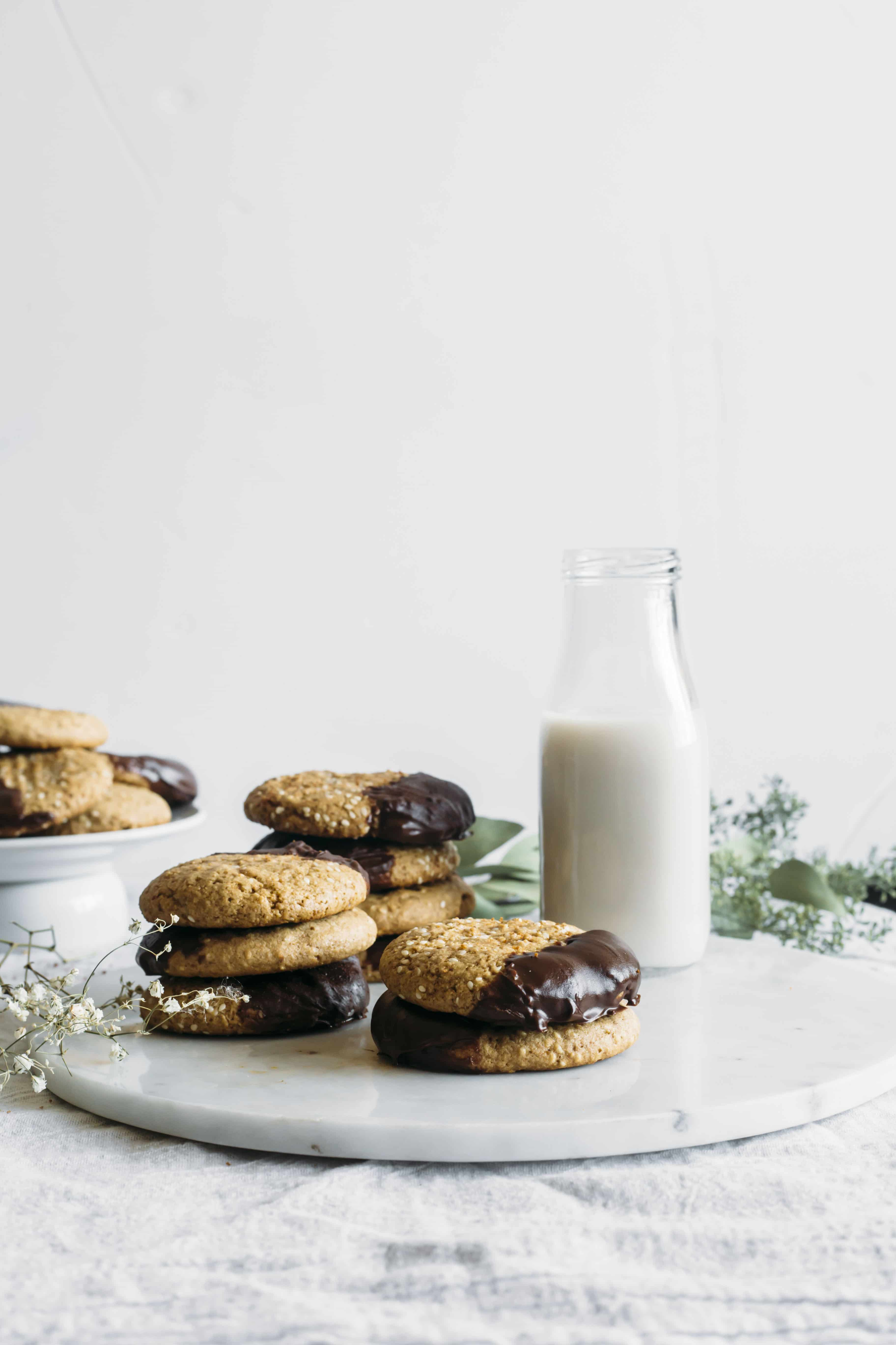 Chocolate Dipped Tahini Cookies | Tahini cookies with added deliciousness thanks to a bit of chocolate!
