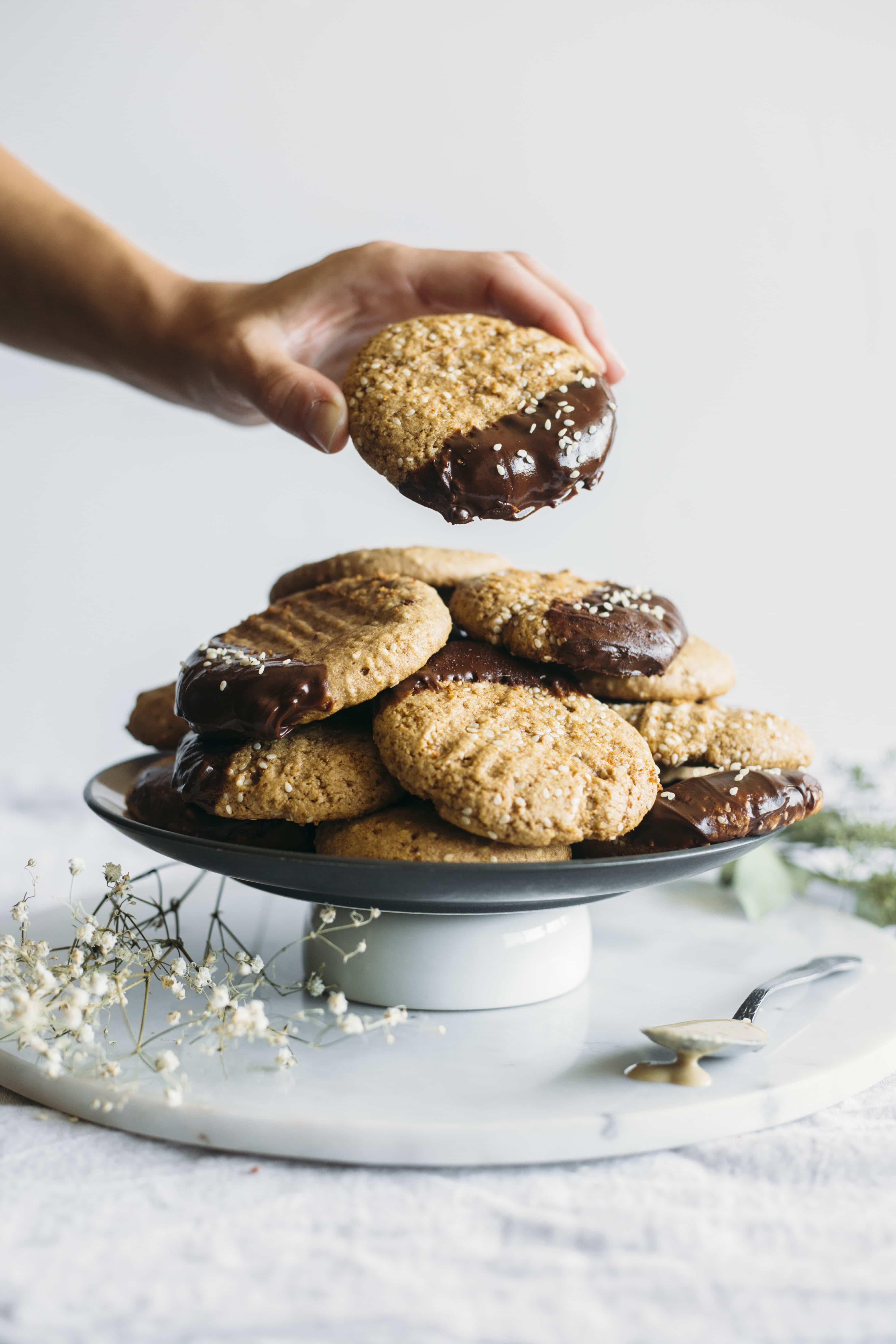 Chocolate Dipped Tahini Cookies | Tahini cookies plus chocolate is a dessert you gotta try for yourself!