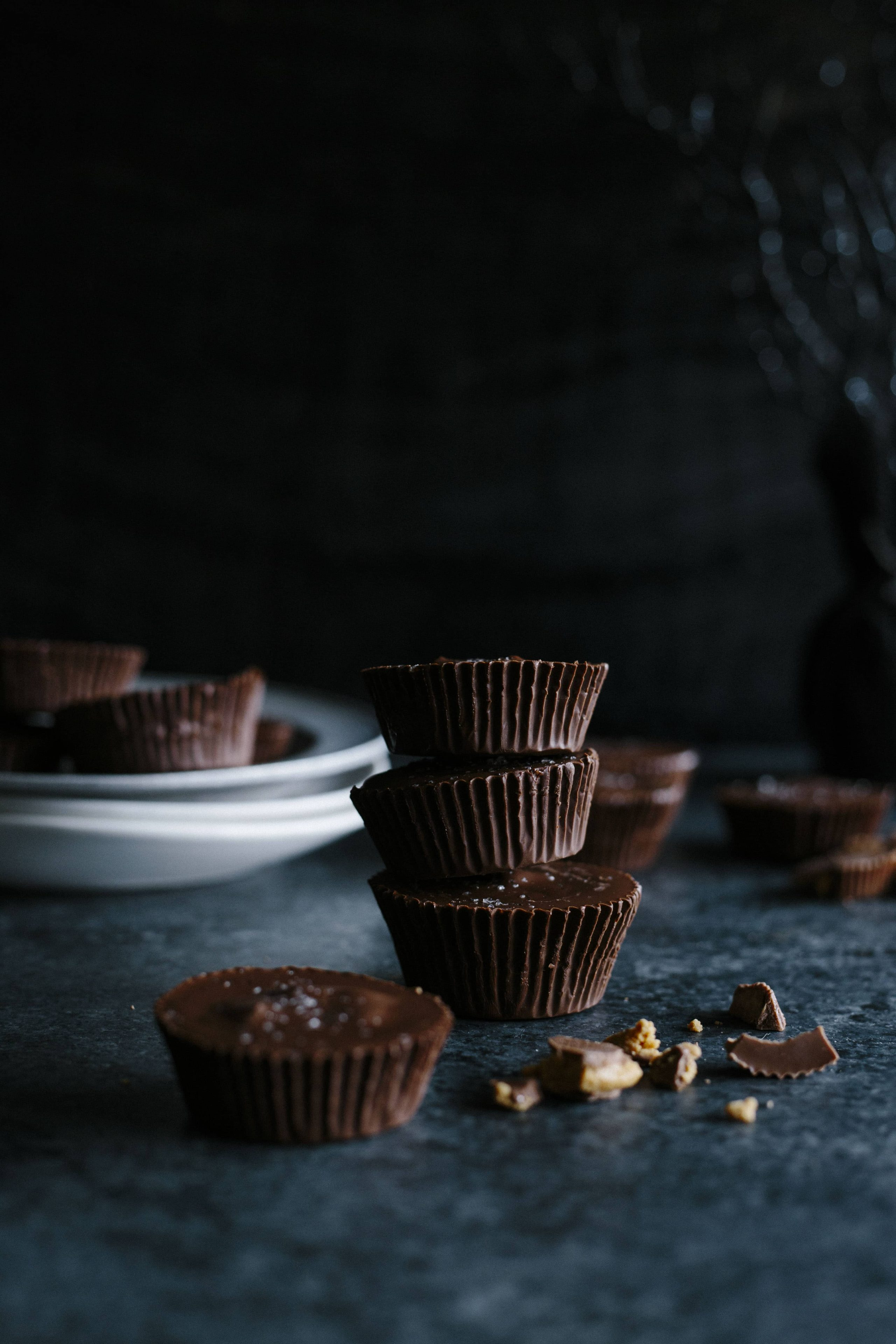 Halloween Candy Cups | Make your own 3-ingredient chocolate cups filled with leftover Halloween candy! | thealmondeater.com