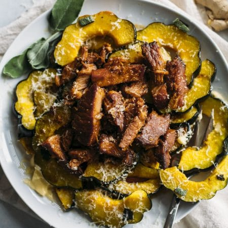 Roasted Acorn Squash | Roasted acorn squash topped with honey ginger pork made in the slow cooker | thealmondeater.com