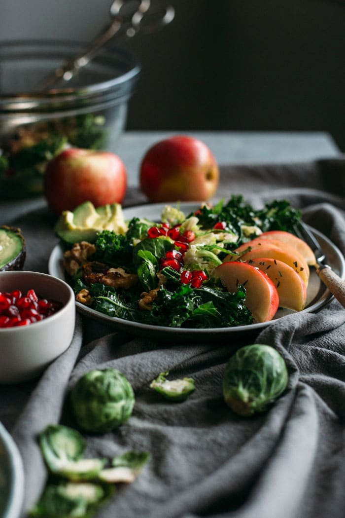 Apple, Kale and Brussels Sprouts Salad | Kale and sprouts topped with apples and dates in this sweet salad that's perfect for the holidays!