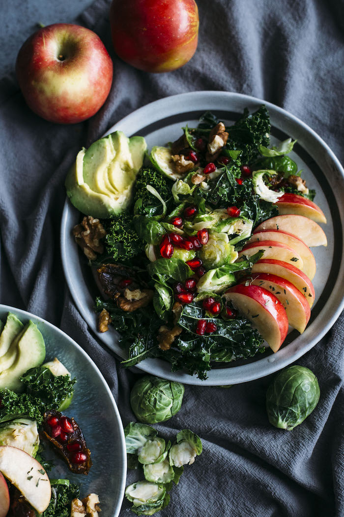 Apple, Kale and Brussels Sprouts Salad | All of your favorite fall-winter ingredients like apples and pomegranate in one delicious salad!
