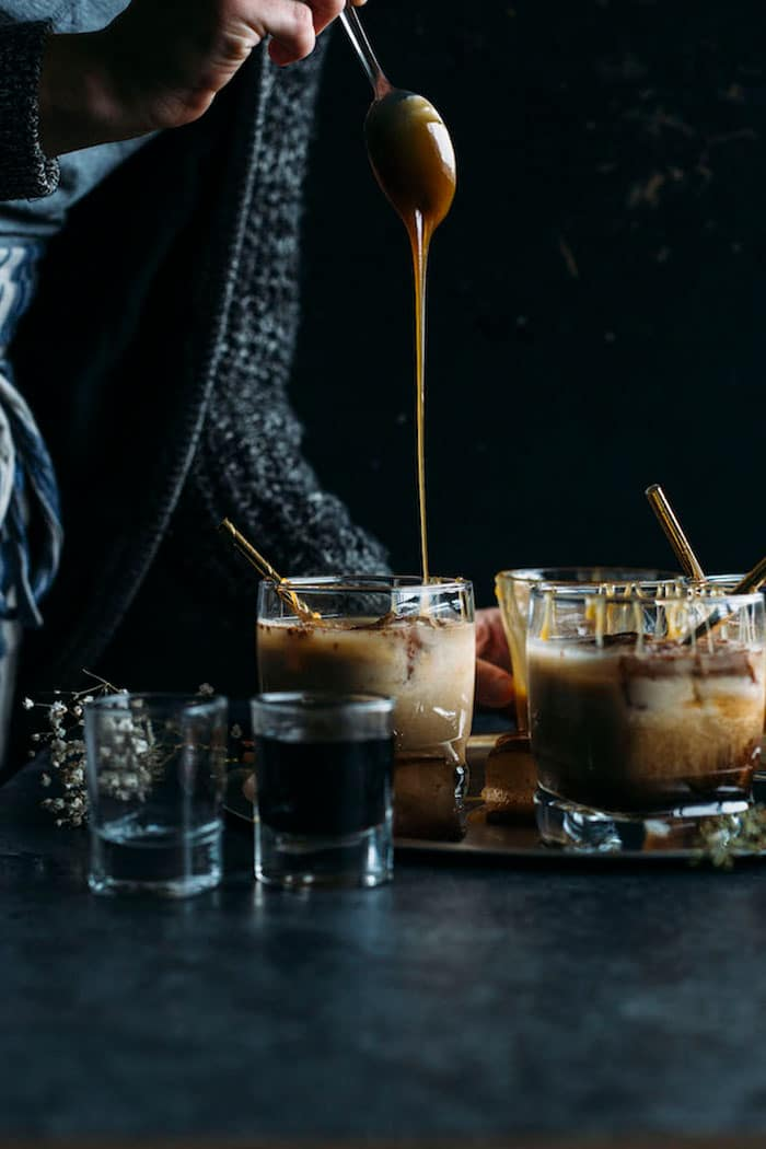Salted Caramel White Russian | Jazz up a traditional White Russian by adding caramel sauce and cinnamon ice cubes | thealmondeater.com