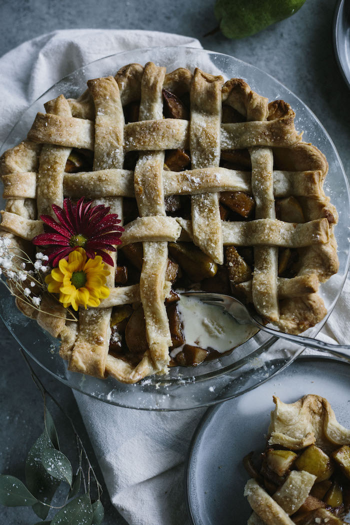 Vegan Pear Pie | A delicious pie filled with chai spice-flavored pears--made extra delicious when served with some dairy free ice cream!