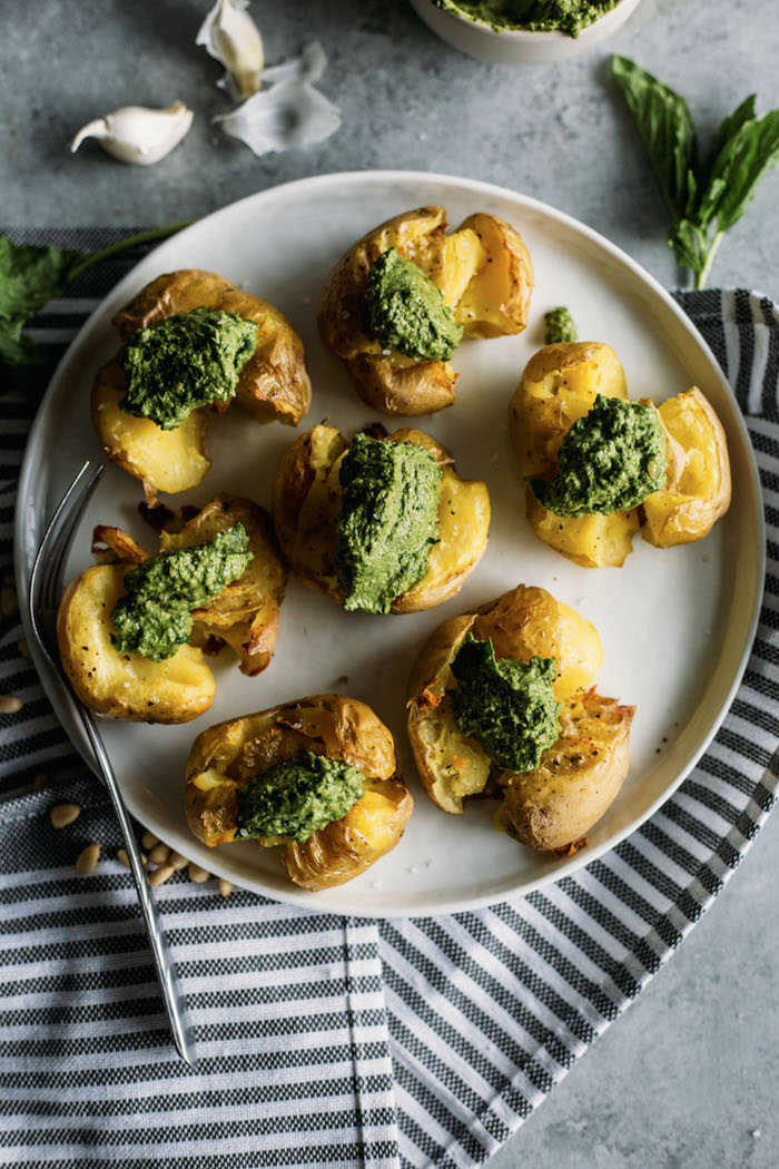 Pesto Smashed Potatoes | CRISPY smashed potatoes topped with kale pesto, aka the perfect side dish!