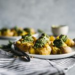 Pesto Smashed Potatoes | Crispy smashed potatoes topped with a vegan-friendly kale pesto!
