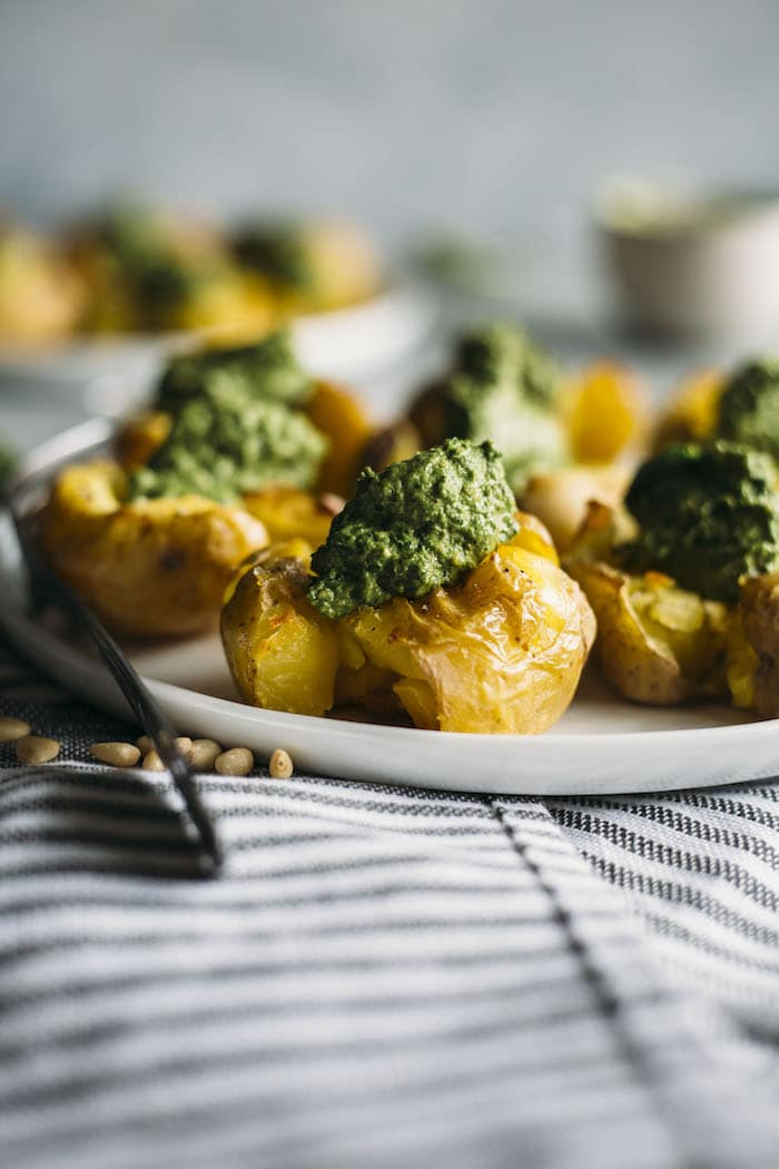 Pesto Smashed Potatoes | CRISPY smashed potatoes topped with a healthy kale pesto, aka the perfect side dish | thealmondeater.com