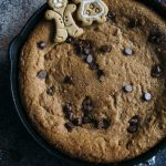 Gingerbread Skillet Cookie | A GIANT gingerbread skillet cookie with chocolate chips--warm and chewy and goes perfectly with some ice cream! | thealmondeater.com