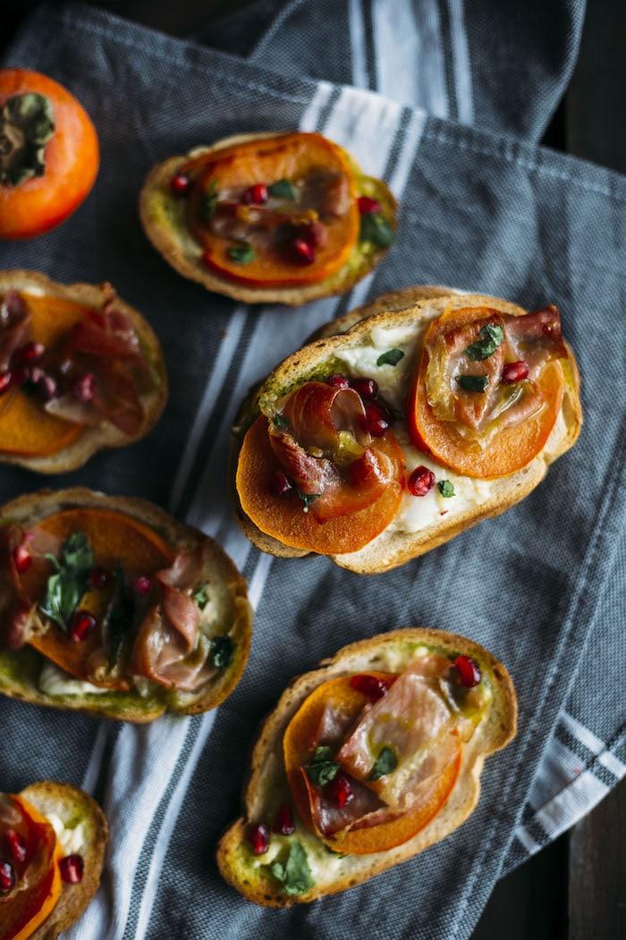 Prosciutto Persimmon Bruschetta | Must-try bruschetta topped with burrata cheese, persimmons and prosciutto! | thealmondeater.com