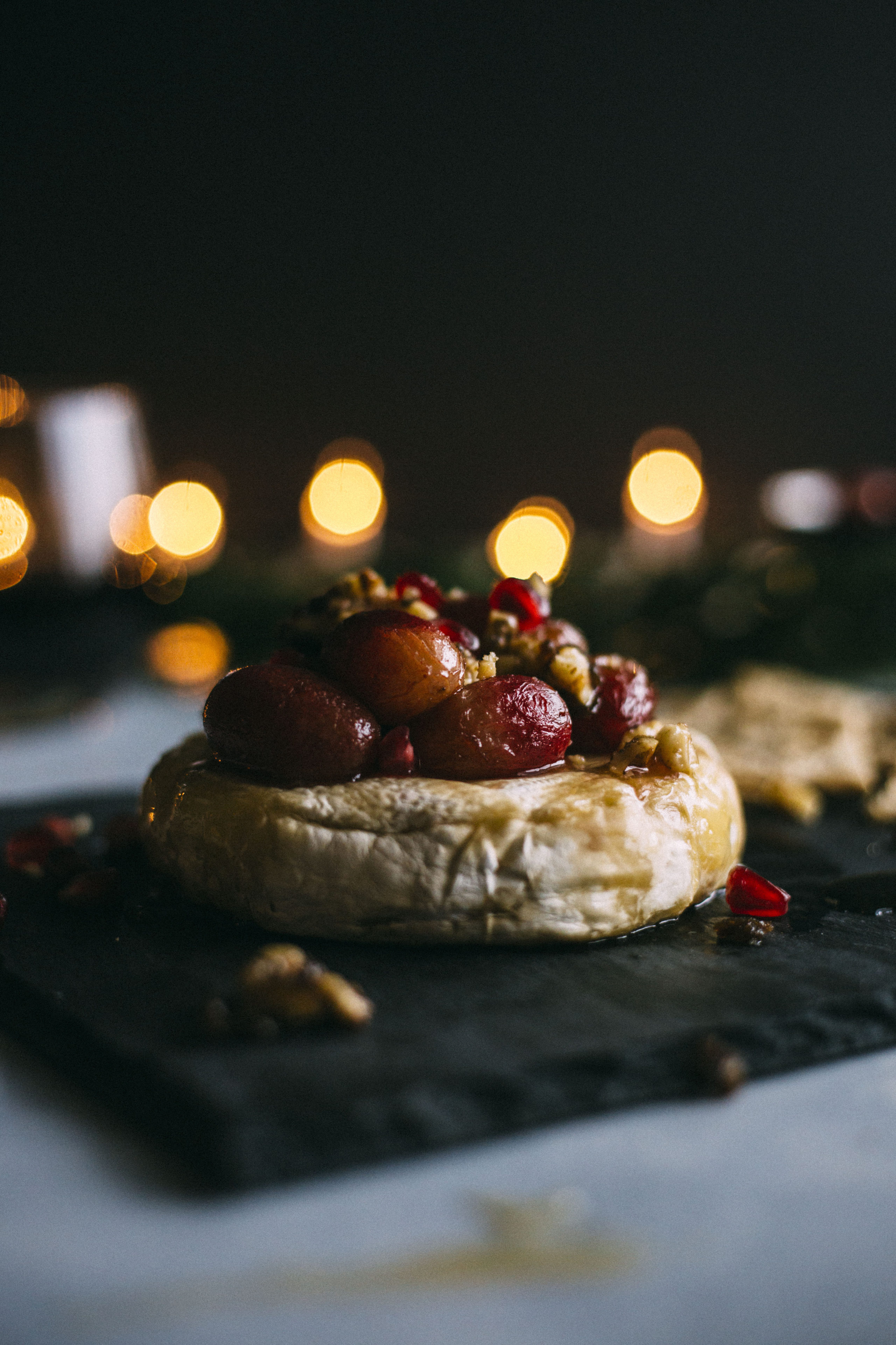 Roasted Grape Baked Brie | Baked brie topped with grapes, caramelized walnuts and honey, aka the perfect appetizer! | thealmondeater.com