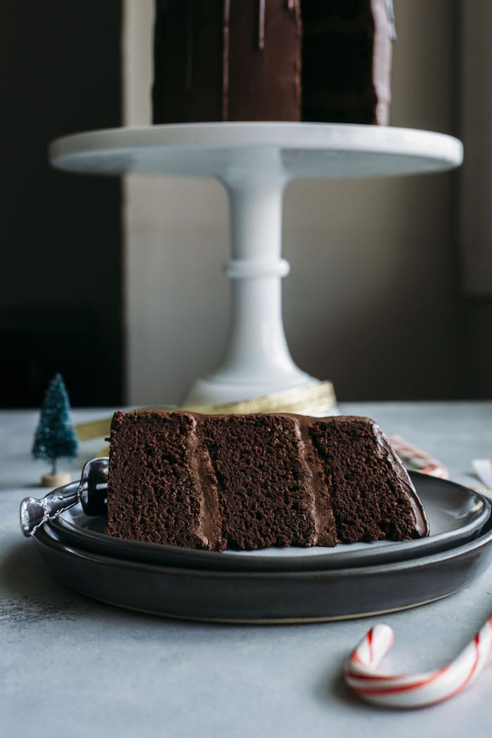 Vegan Chocolate Peppermint Cake   A delicious chocolate peppermint cake covered in a dairy free chocolate ganache, aka the perfect holiday dessert!   thealmondeater.com