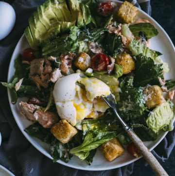 A Salmon Caesar Salad plus bacon, tomato and avocado--all in one salad!